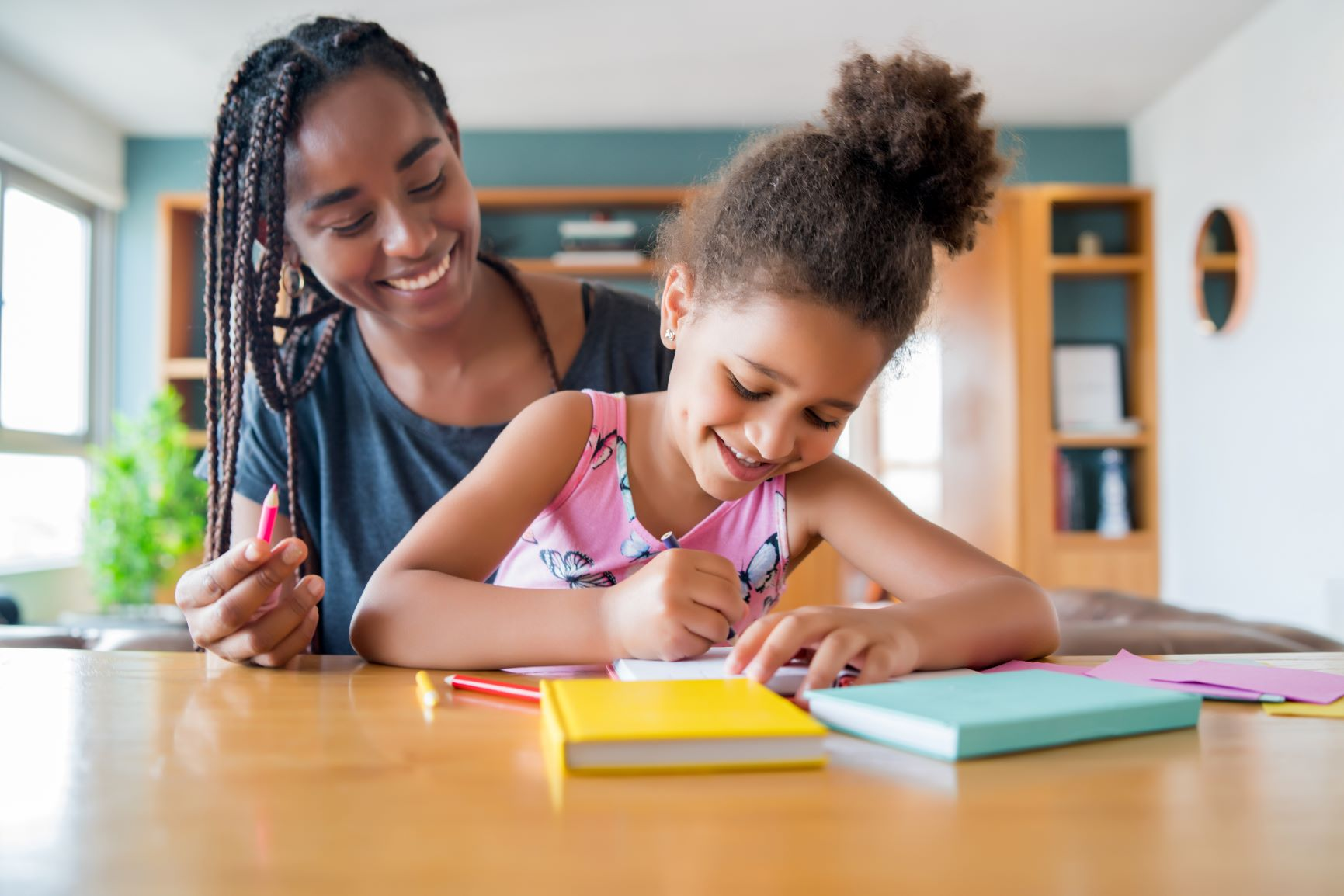 mother-helping-supporting-her-daughter-with-homeschool-while-staying-home-new-normal-lifestyle-concept